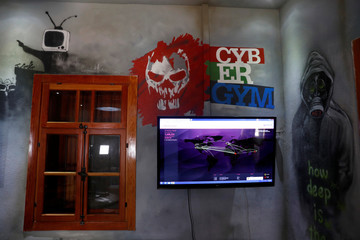 Graffiti is seen near the logo of Cybergym, a cyber-warfare training facility backed by the Israel Electric Corporation, at their training center in Hadera, Israel