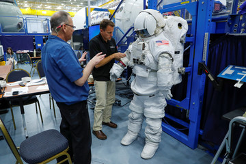 NASA Commercial Crew Astronaut Josh Cassada goes through a space suit fitting session at the Johnson Space Center in Houston,