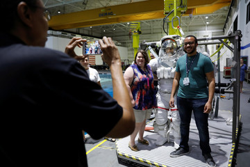 NASA commercial Crew astronaut SunitaWilliams poses for a picture in her space suit before entering the water at NASA's Neutral Buoyancy Laboratory (NBL) training facility near the Johnson Space Center in Houston