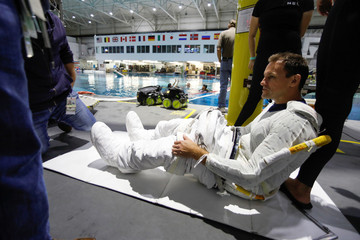 NASA Commercial Crew Astronaut Josh Cassada is helped to get into his space suit at NASA's Neutral Buoyancy Laboratory (NBL) training facility near the Johnson Space Center in Houston