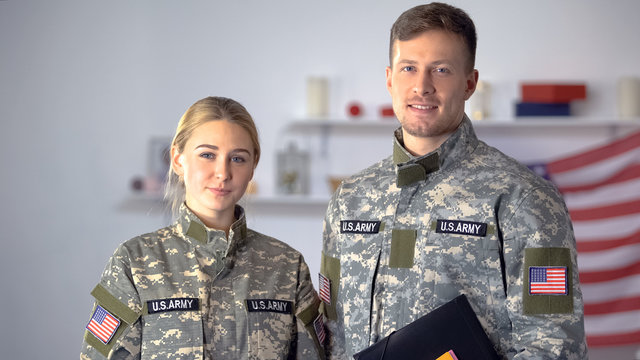 USA students of military academy with folders looking at camera, education