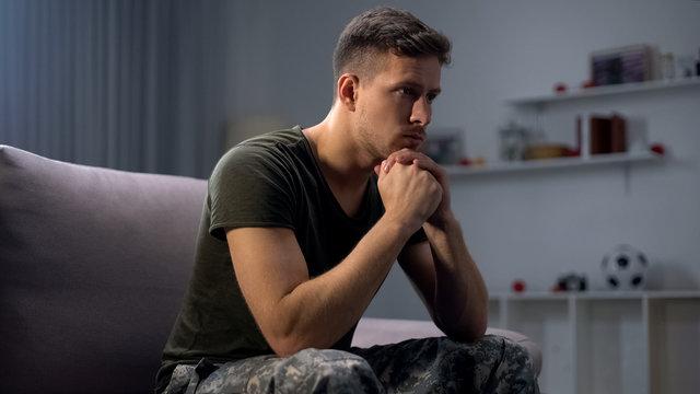 Upset soldier remembering terrifying war, suffering ptsd, psychological help