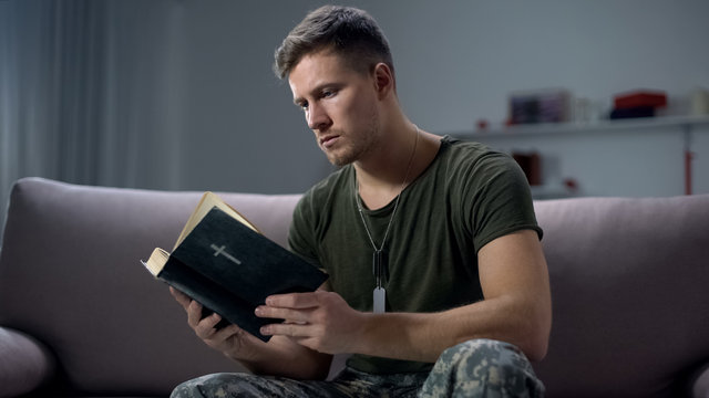 Serious male military reading bible, religion and faith, psychological therapy