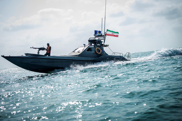 A boat of the Iranian Revolutionary Guard sails, at undisclosed place off the coast of Bandar Abbas