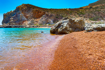 Thiorichia beach or Paliorema - the abandoned sulfur mines - where the rocks, due to the presence of sulphur, are red, orange and yellow