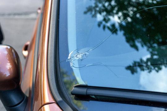 Broken car windshield glass from stone