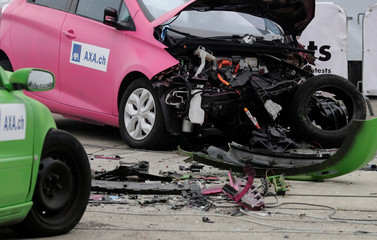 A Renault Zoe electric car (R) is seen after collision with an oncoming Volvo V70 car in a controlled crash test from insurer AXA in Duebendorf