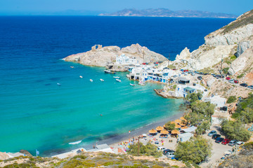 Panoramic view of the beach of Firopotamos village eith the turquoise waters and the colorful fishing houses