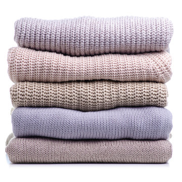Stack folded sweater clothing on white background isolation
