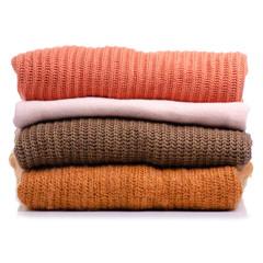 Stack folded sweater clothing on white background isolation