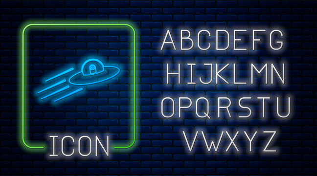Glowing neon UFO flying spaceship and alien icon isolated on brick wall background. Flying saucer. Alien space ship. Futuristic unknown flying object. Neon light alphabet. Vector Illustration