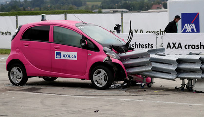 A Mitsubishi i-MiEV electric car collides with crash cushions in a controlled crash test from insurer AXA in Duebendorf
