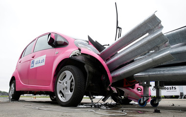 A Mitsubishi i-MiEV electric car is seen after a collision with crash cushions in a controlled crash test from insurer AXA in Duebendorf