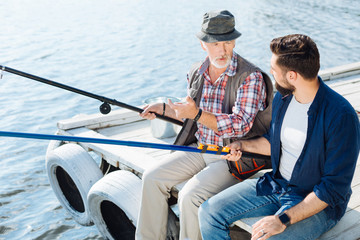 Recess Fitting Water Motor sports Businessman spending weekend with father and fishing together