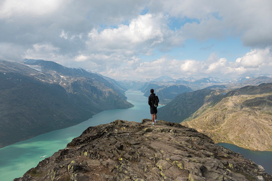 Jotunheimen National Park, Person standing on top of Besseggen looking over the Gjende Fjord