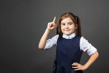 Portrait of a little girl in the school uniform