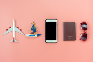 Flat lay image of accessory clothing man or women to plan travel in holiday background concept.Mobile phone & passport with many item in vacation season.Table top view several object on pink paper.