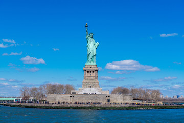 Fototapete - The Statue of Liberty in New York City. Statue of Liberty with blue sky over hudson river on island. Landmarks of lower manhattan New York city.
