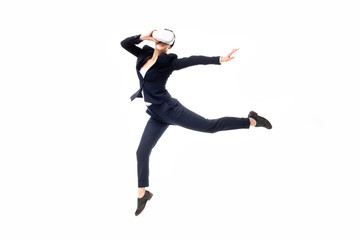 young businesswoman dancing while using virtual reality headset isolated on white