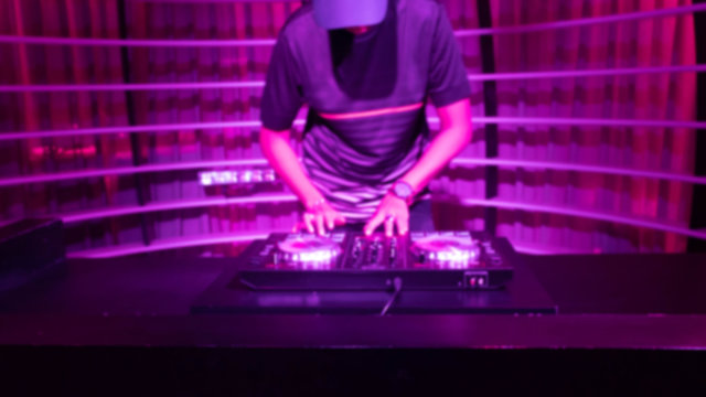portrait of a male with hat Disc jockey or dj playing turn table, mixer, music