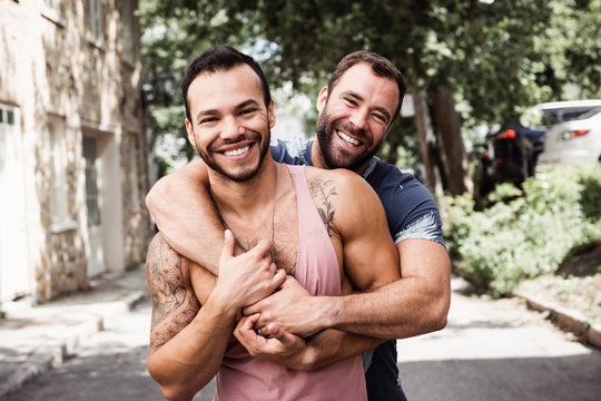 A Portrait of a happy gay couple outdoors in urban background