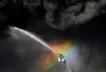Firefighters extinguish a fire at an industrial building in Saint Petersburg