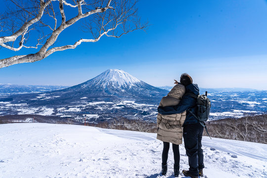 romantic couple in snow mountain, Niseko Hokkaido Yotei