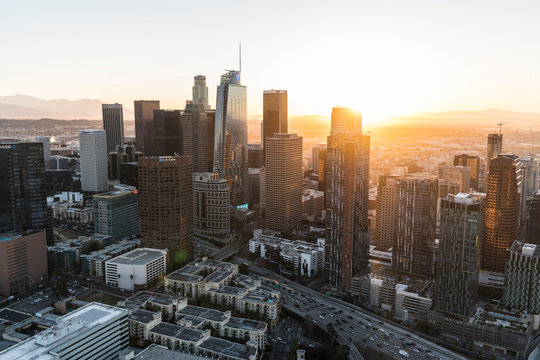 Editorial aerial view of urban downtown Los Angeles office towers at sunrise on February 20, 2018 in Los Angeles, California, USA.