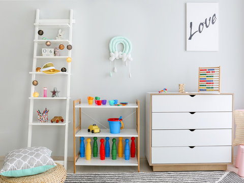 Interior of modern children's room with toys