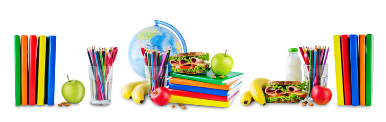 school lunch with a sandwich, fresh fruits and multicolored books on a white isolated background