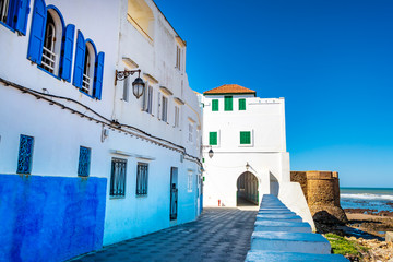 Beautiful view of street with typical arabic architecture. Location: Asilah, North Morocco, Africa. Artistic picture. Beauty world