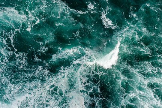 Waves crashing against themselves in dark blue water.