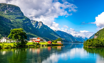 Wall Murals Northern Europe Amazing nature view with fjord and mountains. Beautiful reflection. Location: Scandinavian Mountains, Norway. Artistic picture. Beauty world. The feeling of complete freedom