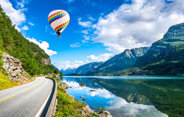 Travel concept. Amazing nature view with fjord and mountains. Beautiful reflection. Location: Scandinavian Mountains, Norway. Artistic picture. Beauty world. The feeling of complete freedom.