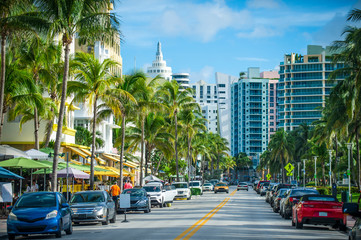 Bright scenic view of Ocean Drive in South Beach, Miami on a light traffic morning