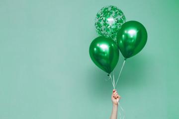 stylish birthday party or holidays with balloons.green balloons on the green background with copy...