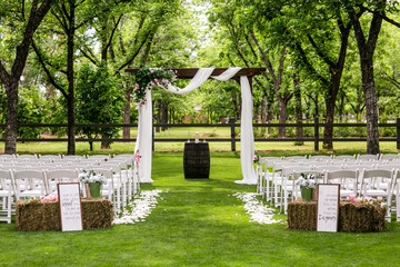 wedding ceremony with arch and trees
