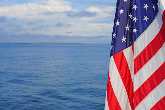 American flag of the United States of America floating off a ferry on the Atlantic Ocean