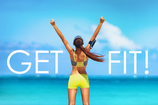 Get FIT motivational message weight loss poster for fitness concept. New Year resolution inspirational quote on beach background. Cheering winner woman with arms up training goal getting in shape.
