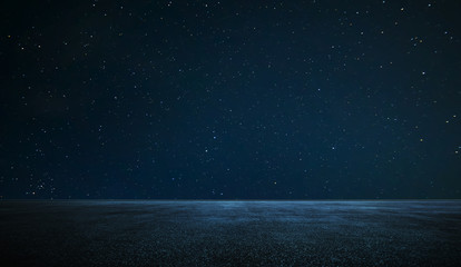 Empty asphalt floor with night sky . Wall mural