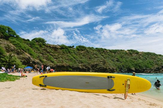 hanauma bay yellow surf board in the sand