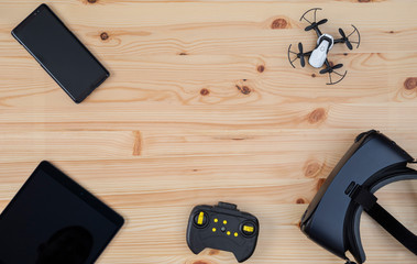 Top view of tablet, smartphone, vr glasses and drone on wooden table