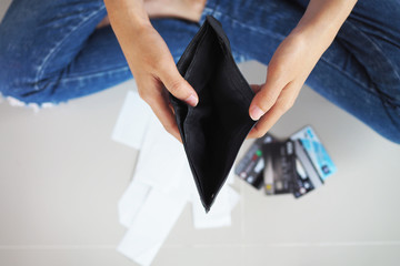 Women sit with strained credit card debt. Because there is no money left in the wallet.