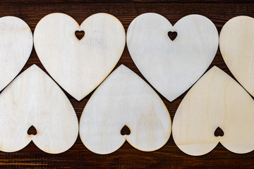 wooden hearts placed nicely on a wooden backgroud