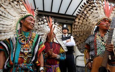 A police officer stands guard as indigenous leaders of the Huni Kuin Kaxinawa from Brazil join a protest organised by Extinction Rebellion against the Brazilian government's environmental polices, outside of the Brazilian Embassy in London, Britain
