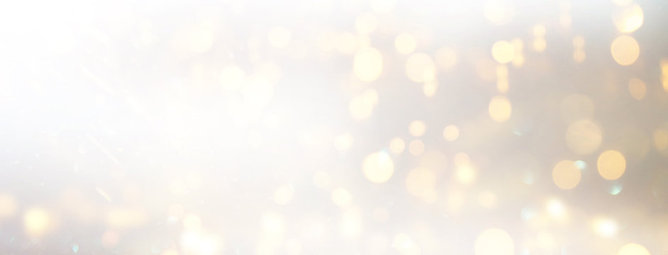 background of abstract glitter lights. silver and gold. de-focused. banner