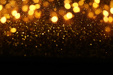 Fototapete - background of abstract glitter lights. gold and black. de-focused