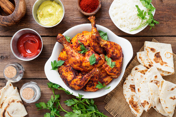 Tandoori chicken with jasmine rice and pita bread, indian cuisine.