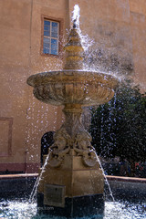 Fountain spurting water at the Poděbrady chateau in the summer