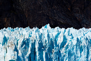 An Alaskan glacier glows when seen from a great distance